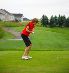 a-female-golfer-taking-her-first-shot-of-the-tee 14834457334 o