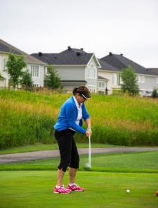 a-female-golfer-taking-her-first-shot-of-the-tee 1 14834462104 o