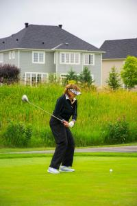 a-female-golfer-taking-her-first-shot-of-the-tee 2 14836819925 o