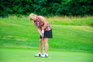 a-female-golfer-watching-here-put 14836459512 o