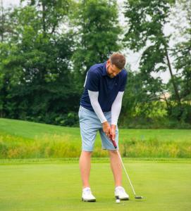 a-golf-golfer-about-to-take-his-putt 14834454924 o