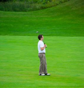 a-golfer-having-a-look-to-see-where-his-ball-landed 14836809885 o