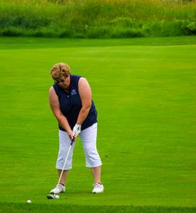 a-lady-golfer-getting-ready-to-take-her-second-shot 14856674323 o